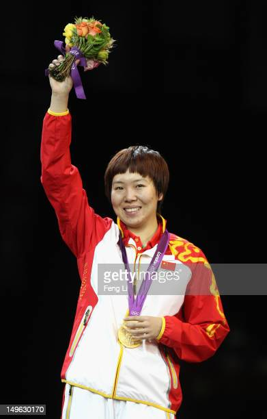 Xiaoxia Li of China stands on the podium after winning the Gold medal in the Women's Singles Table Tennis Gold Medal match against Ning Ding of China...