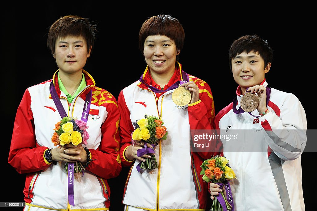 Xiaoxia Li of China stands on the podium after winning the Gold medal, Ning Ding of China (L) the Silver and Tianwei Feng of Singapore (R) the Bronze following the Women's Singles Table Tennis Gold Medal match on Day 5 of the London 2012 Olympic Games at ExCeL on August 1, 2012 in London, England.