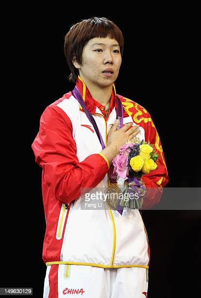 Xiaoxia Li of China stands on the podium for her national anthem after winning the Gold medal in the Women's Singles Table Tennis Gold Medal match...