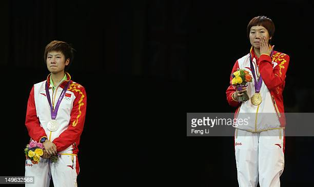 Xiaoxia Li of China stands on the podium for her national anthem after winning the Gold medal and Ning Ding of China the Silver following the Women's...
