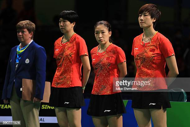 Xiaoxia Li Shiwen Liu and Ning Ding of China pose before the Women's Team Gold Medal Team Match between China and Germany on Day 11 of the Rio 2016...