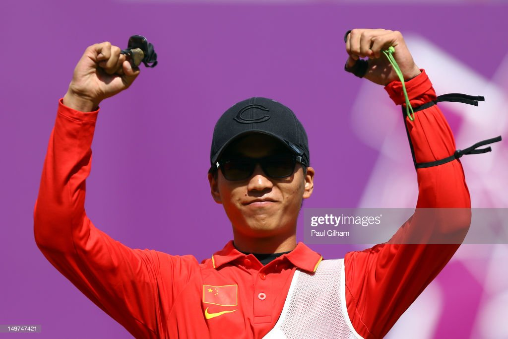 Xiaoxiang Dai of China celebrates after defeating Bubmin Kim of Korea in the Men's Individual Archery Quarterfinal match on Day 7 of the London 2012 Olympic Games at Lord's Cricket Ground on August 3, 2012 in London, England.