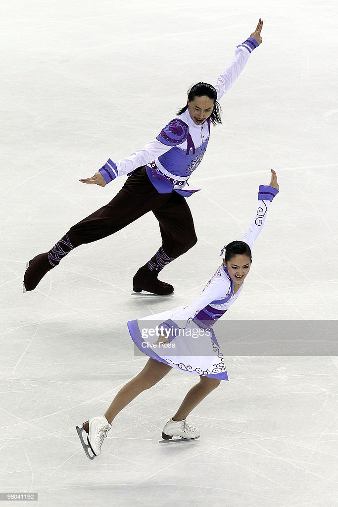 Xiaoyang Yu and Chen Wang of China compete in the Ice Dance Original Dance during the 2010 ISU World Figure Skating Championships on March 25, 2010 at the Palevela in Turin, Italy.