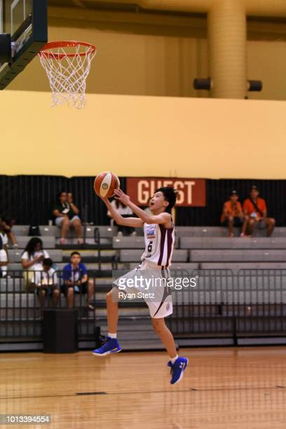 Xiaoyi Zhou of China Girls goes to the basket against Mexico Girls during the Jr NBA World Championships Tournament in Orlando Florida at ESPN Wide...