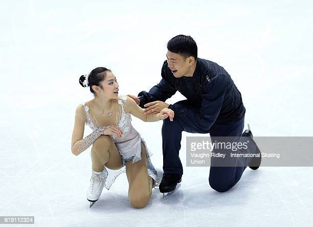Xiaoyu Yu and Hao Zhang of China compete in the Pairs Free Program during the ISU Grand Prix of Figure Skating Skate Canada International at Hershey...