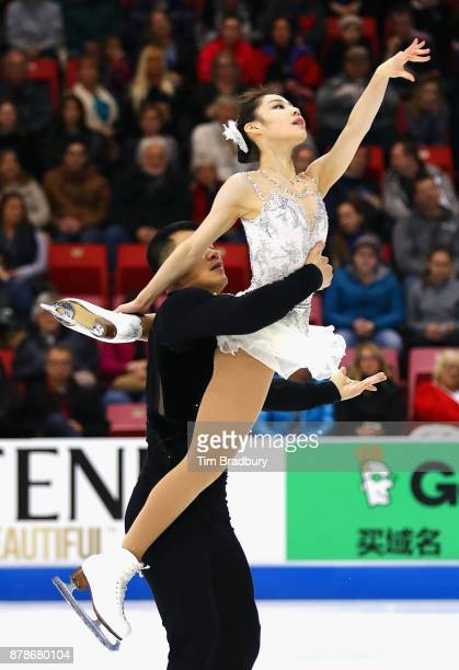 Xiaoyu Yu and Hao Zhang of China compete in the Pairs Short Program during day one of 2017 Bridgestone Skate America at Herb Brooks Arena on November...