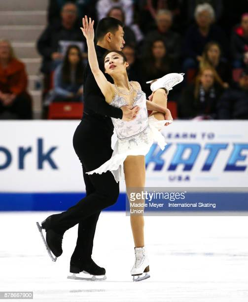 Xiaoyu Yu and Hao Zhang of China perform during the Pairs Short program on Day 1 of the ISU Grand Prix of Figure Skating at Herb Brooks Arena on...