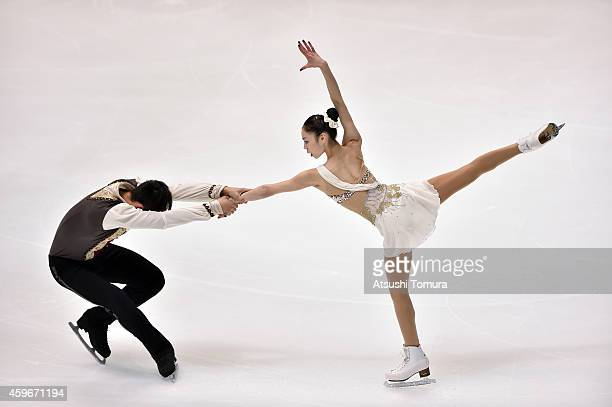 Xiaoyu Yu and Yang Jin of China compete in the Pairs Short Program during day one of ISU Grand Prix of Figure Skating 2014/2015 NHK Trophy at the...