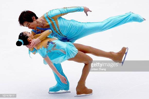 Xiaoyu Yu and Yang Jin of China skate in the Junior Pairs Short Program during ISU Grand Prix and Junior Grand Prix Final at Beijing Capital...