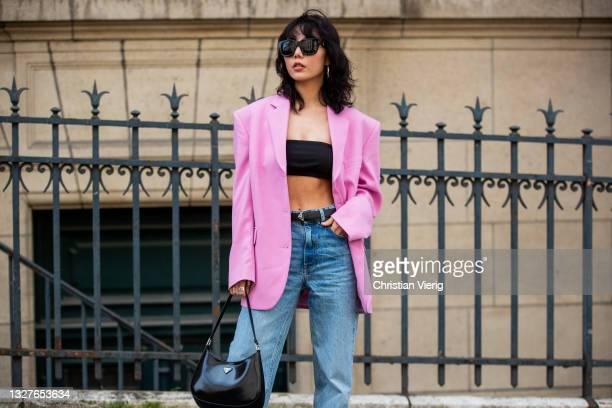 Xiayan is seen wearing pink blazer, cropped top, prada bag, denim jeans outside Zuhair Murad on July 07, 2021 in Paris, France.