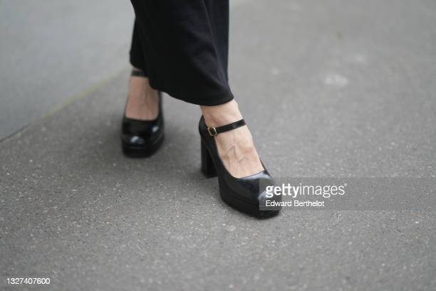 Xiayan wears a black long tube dress, black shiny leather block heels pumps shoes, outside Chanel, during Paris Fashion Week - Haute Couture...