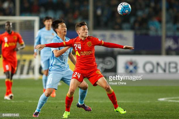 Xie Pengfei of Jiangsu Suning and Jordan O'Doherty of Adelaide United compete for the ball during the AFC Champions League 2017 Group H match between...