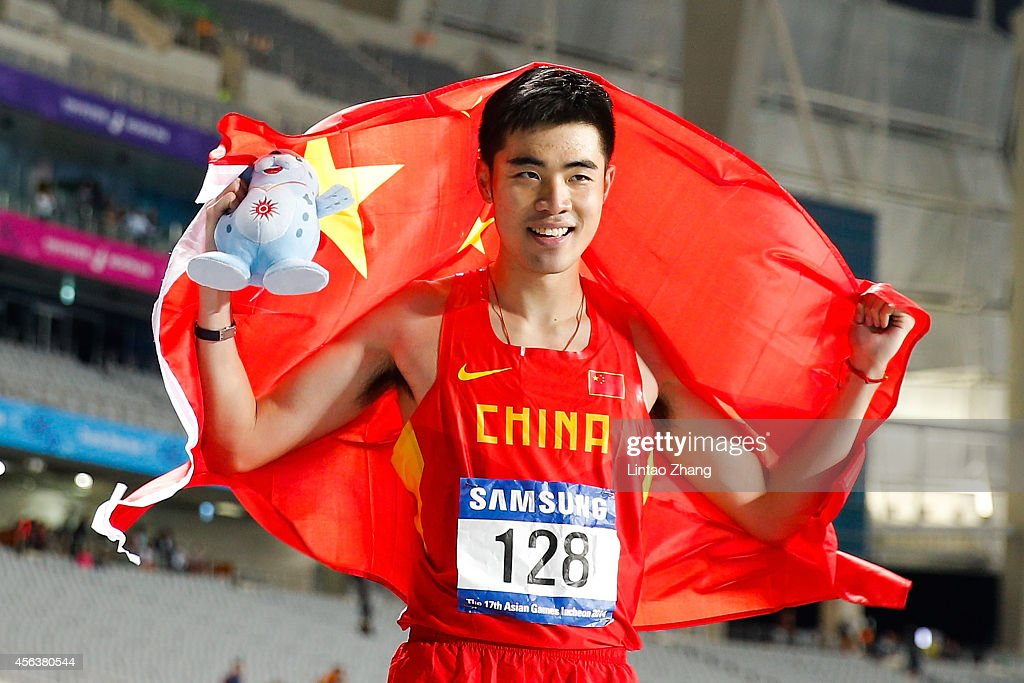 Xie Wenjun celebrates after winning the men's 110-meter hurdles on day eleven of the 2014 Asian Games at Incheon Asiad Main Stadium on September 30, 2014 in Incheon, South Korea.