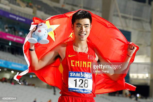 Xie Wenjun celebrates after winning the men's 110-meter hurdles on day eleven of the 2014 Asian Games at Incheon Asiad Main Stadium on September 30,...