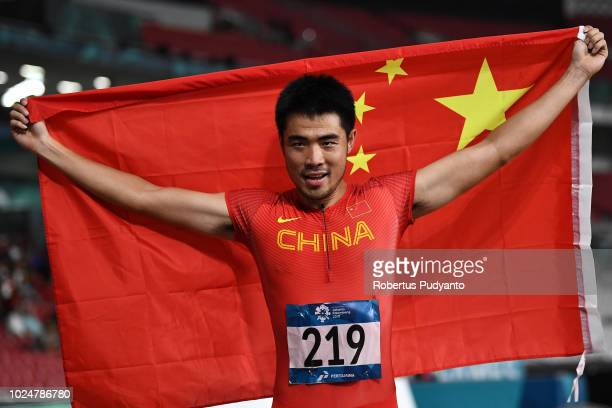 Xie Wenjun of China celebrates victory after winning Men's 110m Hurdles Final on day ten of the Asian Games on August 28 2018 in Jakarta Indonesia