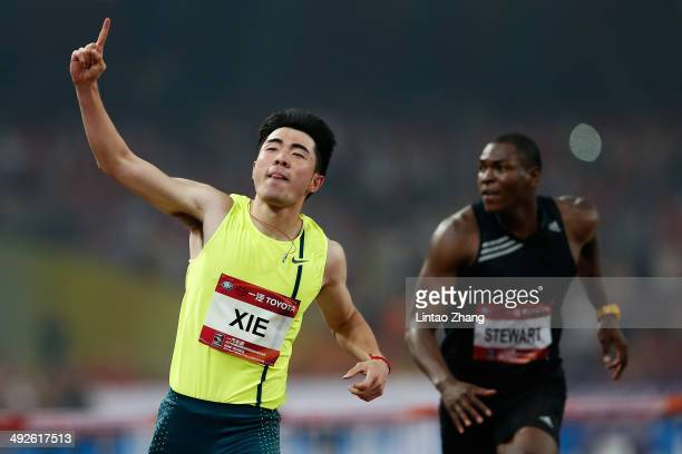 Xie Wenjun of China celebrates winning the men's 110meter hurdles during 2014 IAAF World Challenge Beijing at National Stadium on May 21 2014 in...