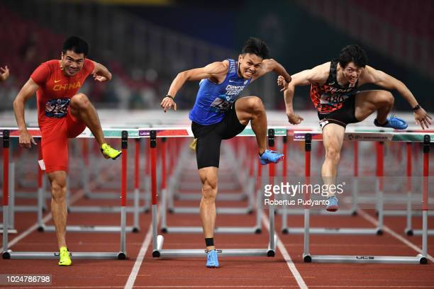 Xie Wenjun of China Chen Kueiru of Chinese Taipei and Shunya Takayama of Japan compete during Men's 110m Hurdles Final on day ten of the Asian Games...