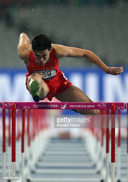 Xie Wenjun of China competes in the Men's 110m heat during day nine of the 2014 Asian Games at Incheon Asiad Main Stadium on September 28 2014 in...