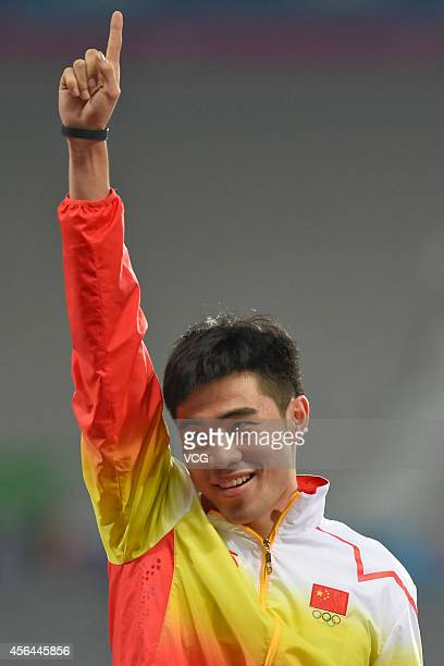 Xie Wenjun of China wins gold medal in man's 110m hurdle during day twelve of the 2014 Asian Games at Incheon Asiad Main Stadium on October 1 2014 in...