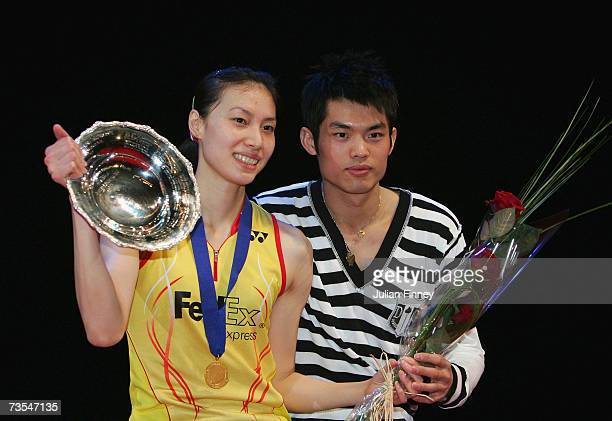 Xie Xingfang of China celebrates with the trophy with boyfriend Dan Li of China after their victory over Pi Hongyan of France in the Women?s Singles...