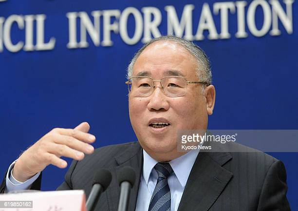 Xie Zhenhua, China's special representative for climate change, speaks at a news conference in Beijing on Nov. 1, 2016. He urged Japan to ratify the...
