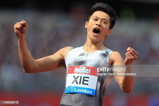 Xie Zhenye of China celebrates winning the Men's 200m during Day Two of the Muller Anniversary Games IAAF Diamond League event at the London Stadium...