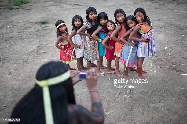 Xikrin girls pose for a portrait during a festival For the Xikrin people of the Xingu Region of Brazil's Amazon Rainforest construction of the...
