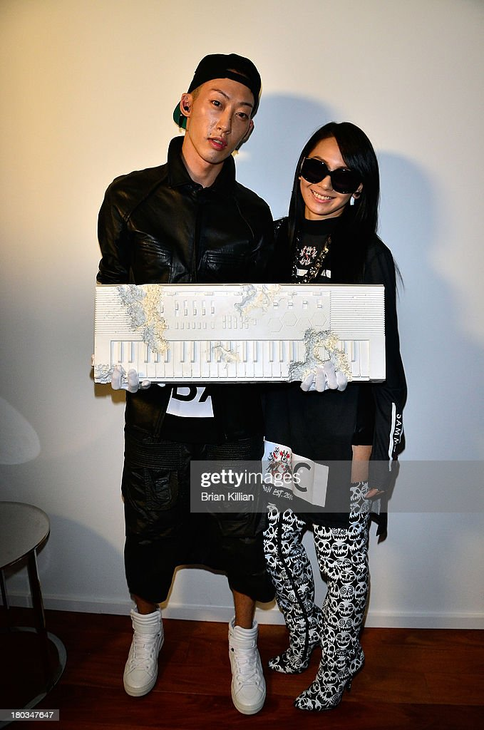 Xim Yang and recording artist CL attend the Daniel Ashram and Pharrell Williams Fashion Week party at The Standard East Village on September 11, 2013 in New York City.