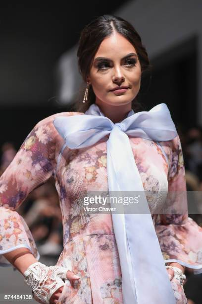 Ximena Navarrete and fashion designers Benito Santos walk the runway during Mercedes Benz Fashion Week Mexico Spring/Summer 2018 at Altto San Angel...