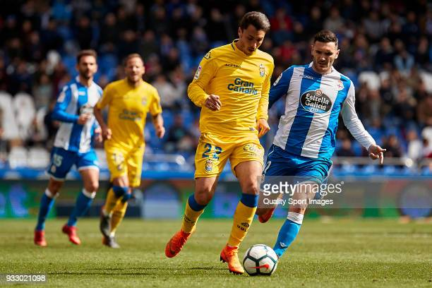 Ximo Navarro of UD Las Palmas is challenged by Lucas Perez of Deportivo de La Coruna during the La Liga match between Deportivo La Coruna and Las...