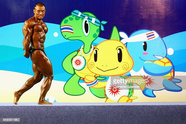 Xin Jian of China poses during the Open Weight Category Bodybuilding competition during the 2014 Asian Beach Games at Karon Beach on November 21 2014...