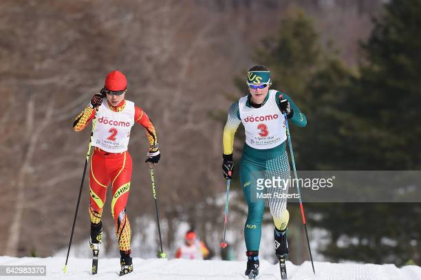 Xin Li of China and Casey Wright of Australia compete in the Women's Cross Country 14 km Individual Sprint Classical on day three of the 2017 Sapporo...