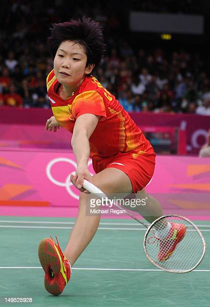 Xin Wang of China competes during her Women's Singles Badminton match against Rena Wang of the United States on Day 3 of the London 2012 Olympic...