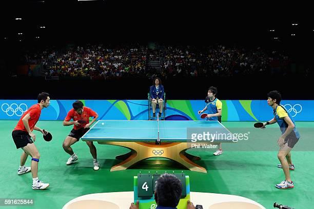 Xin Xu and Jike Zhang of China compete during the Men's Table Tennis gold medal match against Koki Niwa and Maharu Yoshimura of Japan at Riocentro -...
