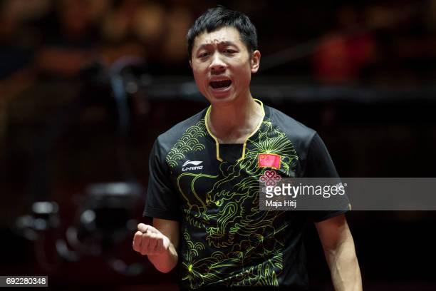 Xin Xu of China celebrates during Men's Singles quarter final against Tomokazu Harimoto of Japan at Table Tennis World Championship at at Messe...