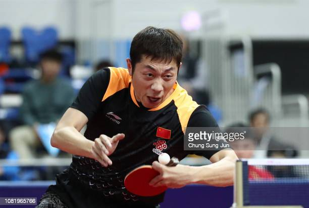 Xin Xu of China competes against Chun Ting Wong of Hong Kong in the Men's Singles - Round of 16 during day one of the World Tour Grand Finals at...