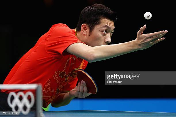 Xin Xu of China competes during the Men's Table Tennis gold medal match against Jun Mizutani of Japan at Riocentro - Pavilion 3 on Day 12 of the Rio...