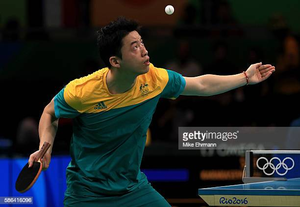 Xin Yan of Australia plays a Men's Singles preliminary match against Aleksandar Karakasevic of Serbia on Day 1 of the Rio 2016 Olympic Games at...
