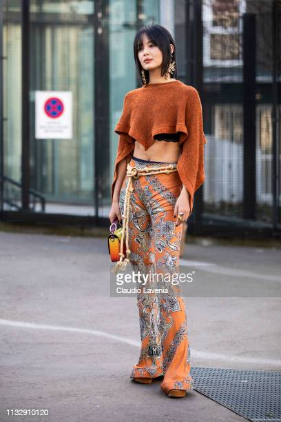 Xin Zhilei wearing a cropped orange sweater printed trousers and orange bag is seen outside Chloe on Day 4 Paris Fashion Week Autumn/Winter 2019/20...
