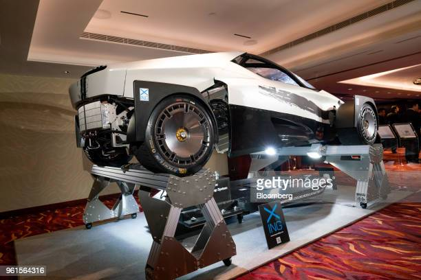 Xing Mobility Inc's Miss R electric supercar and modular battery system stand on display in Hong Kong China on Wednesday May 23 2018 Xing Mobility...