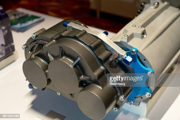 Xing Mobility Inc's torque vectoring gear box stands on display in Hong Kong China on Wednesday May 23 2018 Xing Mobility Chief Executive Officer...