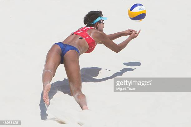 Xinji Xiaof China dives for the ball during the third place final match of the 2014 FIVB Beach Volleyball World Tour on May 11 2014 in Puerto...