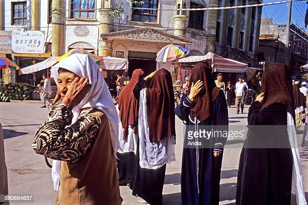 Xinjiang Province officially 'Xinjiang Uyghur Autonomous Region' veiled women in Urumtchi