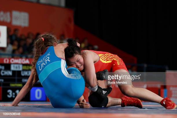 Xinru Zhou of Chine defeats Oksana Chudyk of Ukraine in Women's Freestyle 65kg Gold Medal Matchduring day 7 of Buenos Aires Youth Olympic Games 2018...