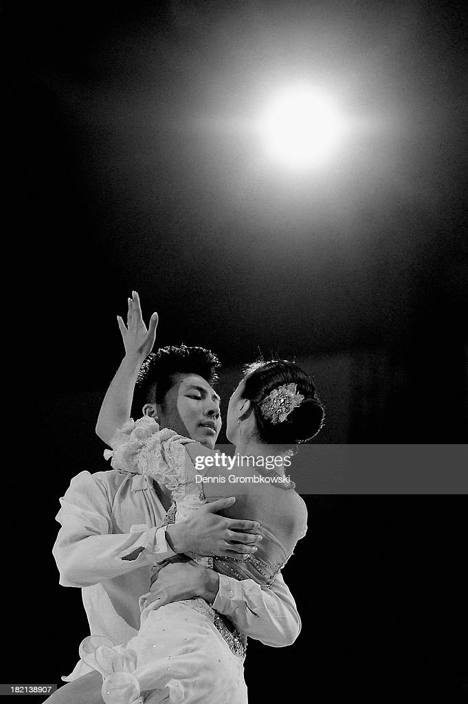 Xintong Huang and Xun Zheng of China perform during an exhibition skate during day three of the ISU Nebelhorn Trophy at Eissportzentrum Oberstdorf on September 28, 2013 in Oberstdorf, Germany.