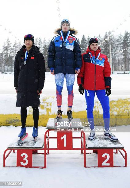 Xinxuan Ma of China with the silver medal Egor Shkolin of Russia with the gold medal and Aleksandr Podolskii of Russia with the bronze medal...