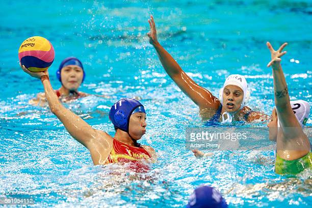 Xinyan Wang of China is challenged by Diana Abla of Brazil during the Women's Water Polo 7th 8th Classification match between Brazil and China on Day...