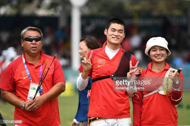 Xinyan Zhang and Tianyu Xu of China celebrate their bronze medals during Recurve Mixed Team Archery Final Rounds on day nine of the Asian Games on...