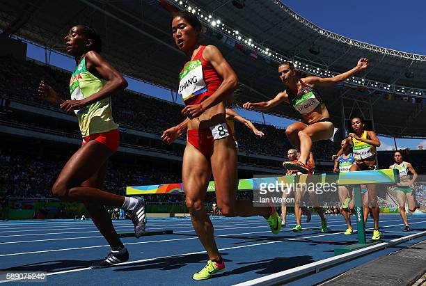 Xinyan Zhang of China and Etenesh Diro of Ethiopia compete in the Women's 3000m Steeplechase Round 1 on Day 8 of the Rio 2016 Olympic Games at the...