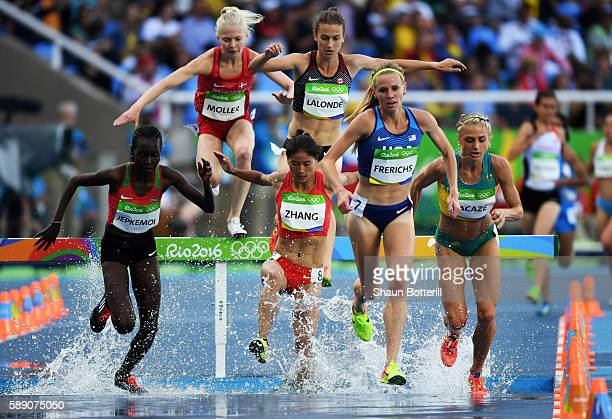Xinyan Zhang of China Courtney Frerichs of the United States and Hyvin Kiyeng Jepkemoi of Kenya compete in the Women's 3000m Steeplechase Round 1 on...